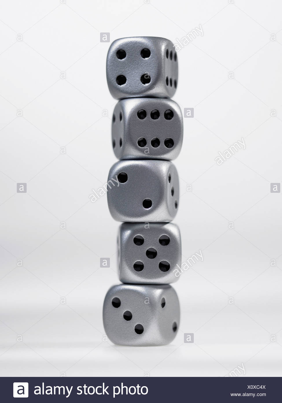 Close up of stack of silver dice - Stock Image