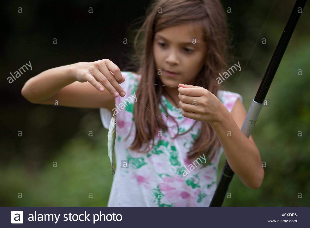Girl with her fish catch - Stock Image