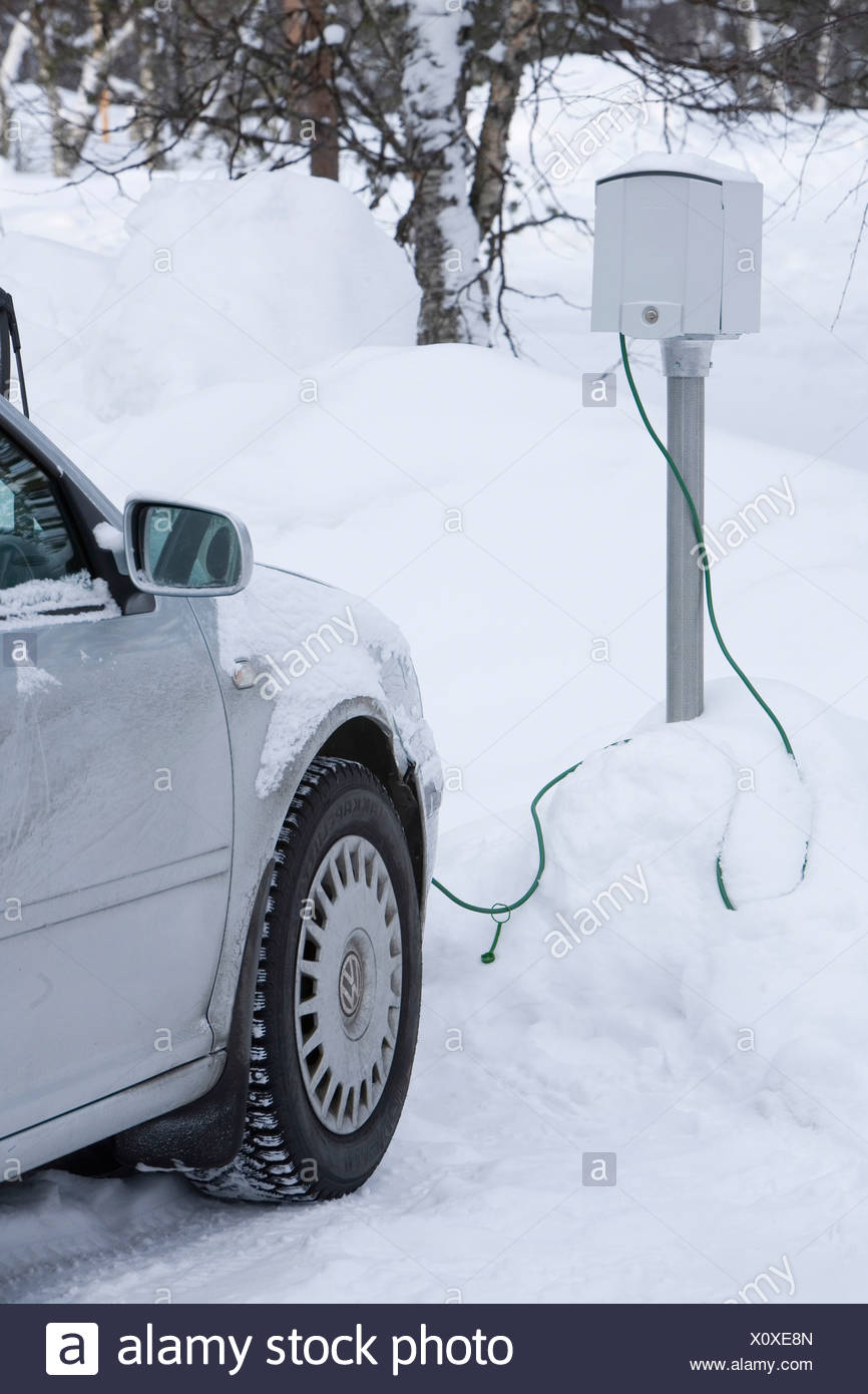 Driving in Saariselka Northern Finland A car plugged into an