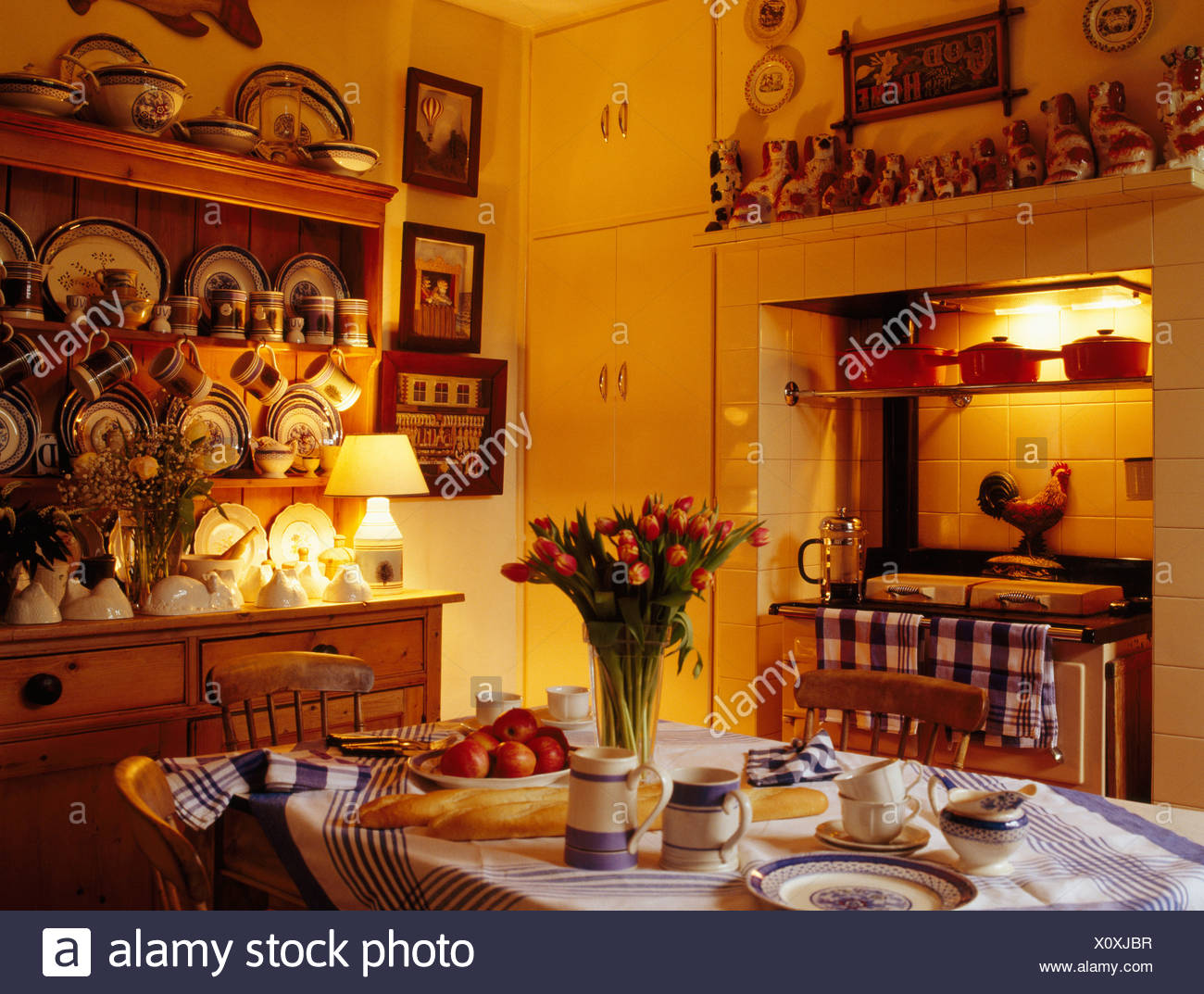 Table Set For Tea In Pale Yellow Country Kitchen With