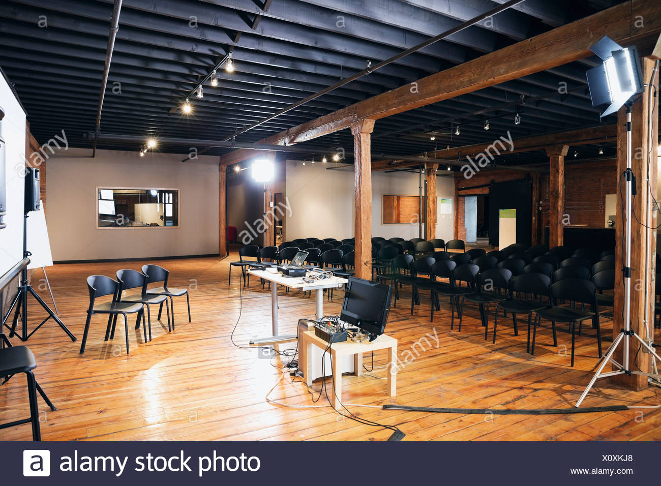 Interior of conference room with projection screen and chairs - Stock Image