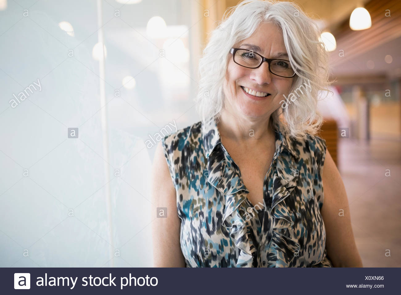 c60570b357 Portrait confident businesswoman with gray hair and eyeglasses - Stock Image