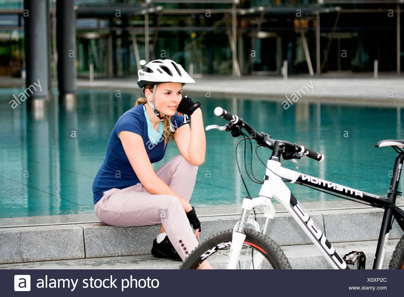 Female cyclist in an urban surrounding - Stock Image