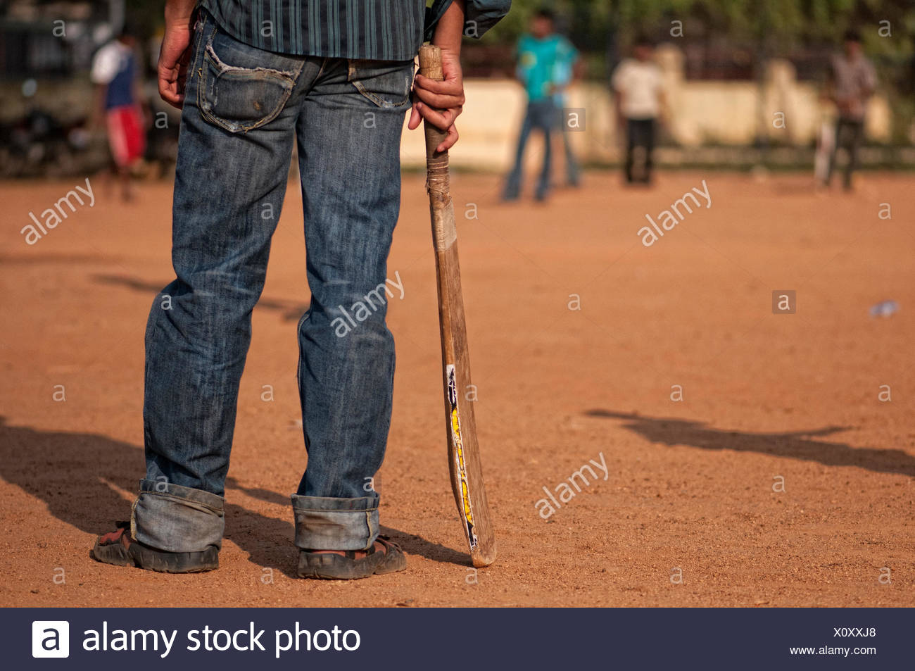Indian boys play cricket at the school cricket ground in Teynampet, Chennai, India. - Stock Image