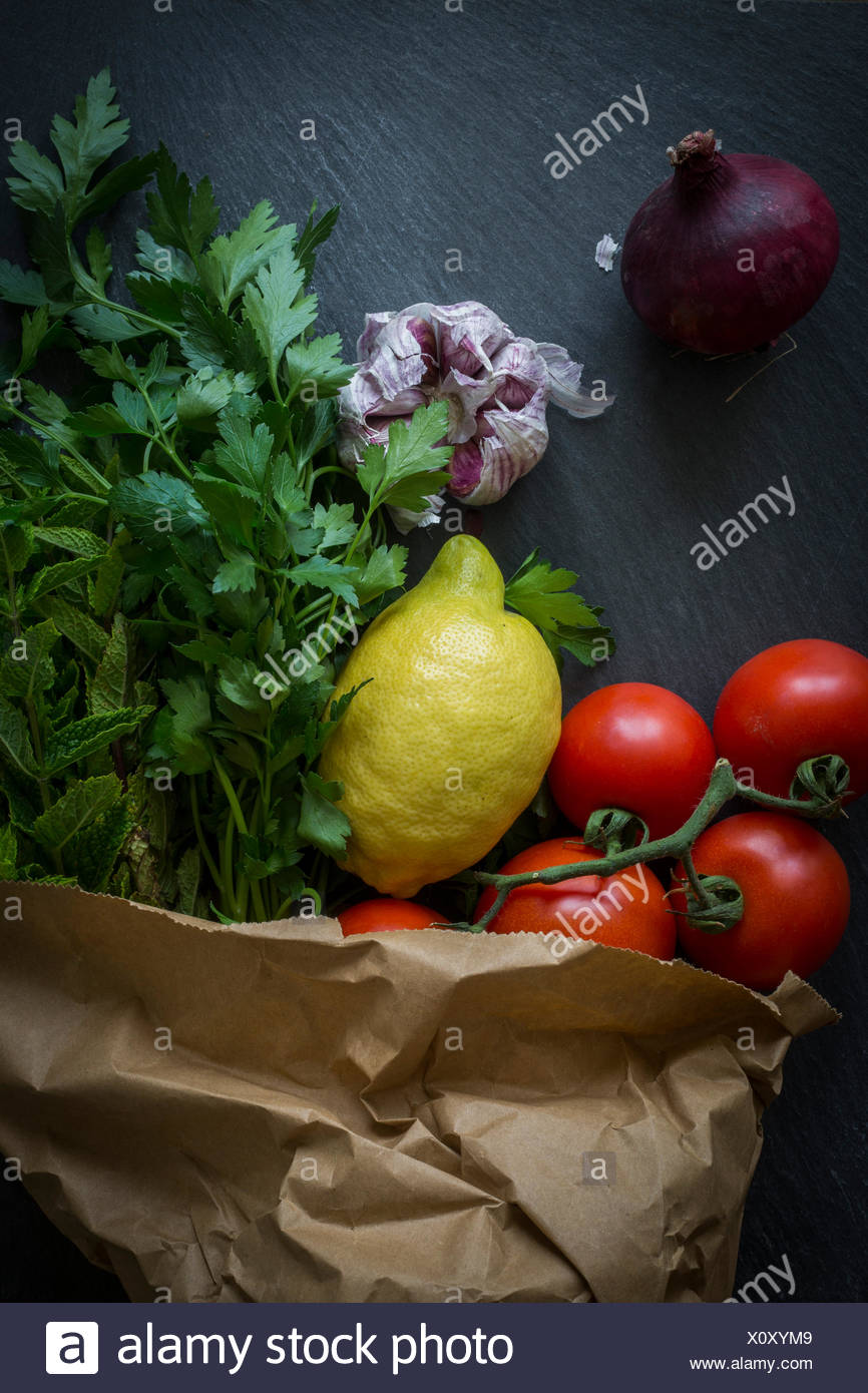 Vegetables in paper bag fresh from the market on slate background: Top view Stock Photo