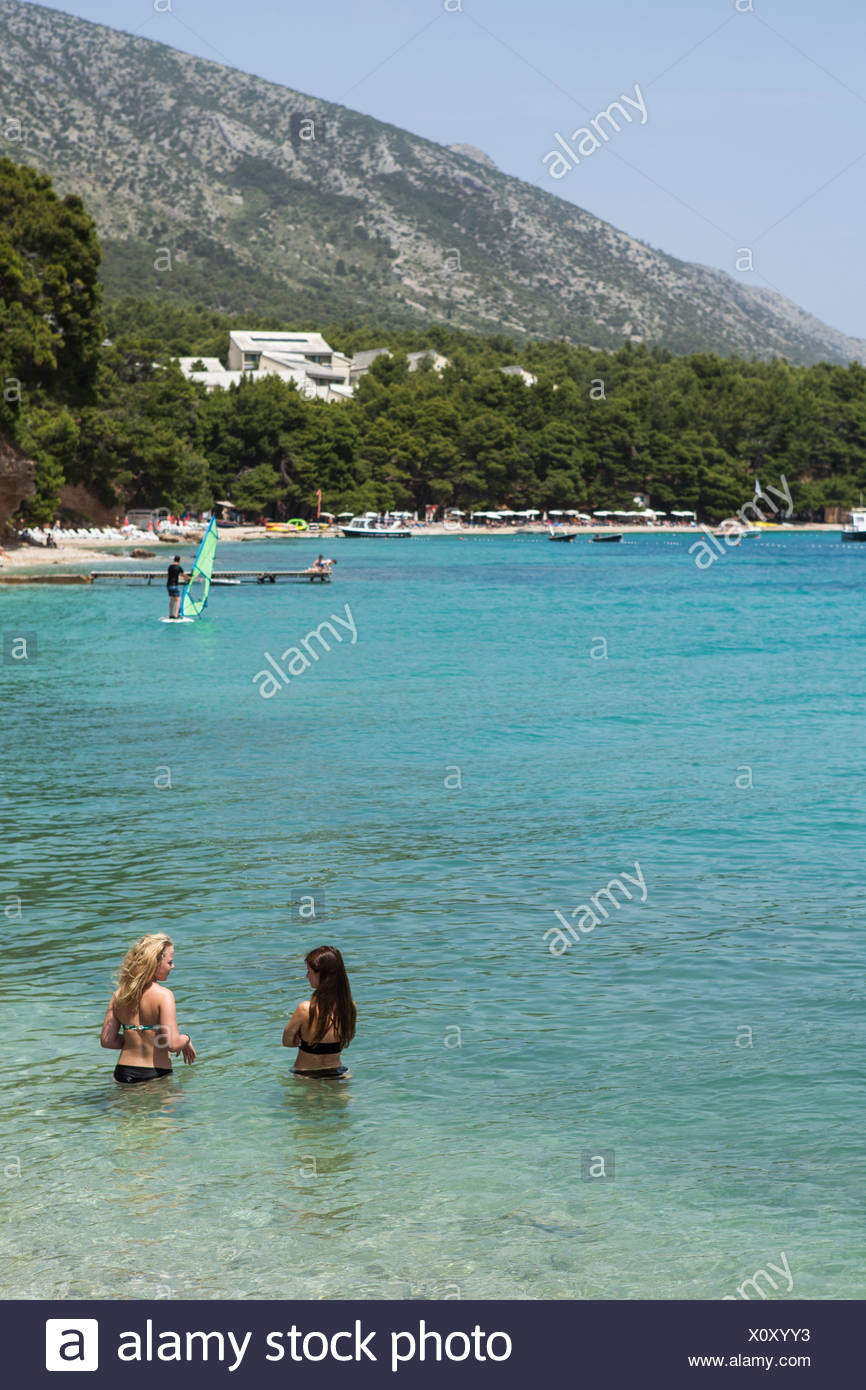 Two women in the sea - Stock Image