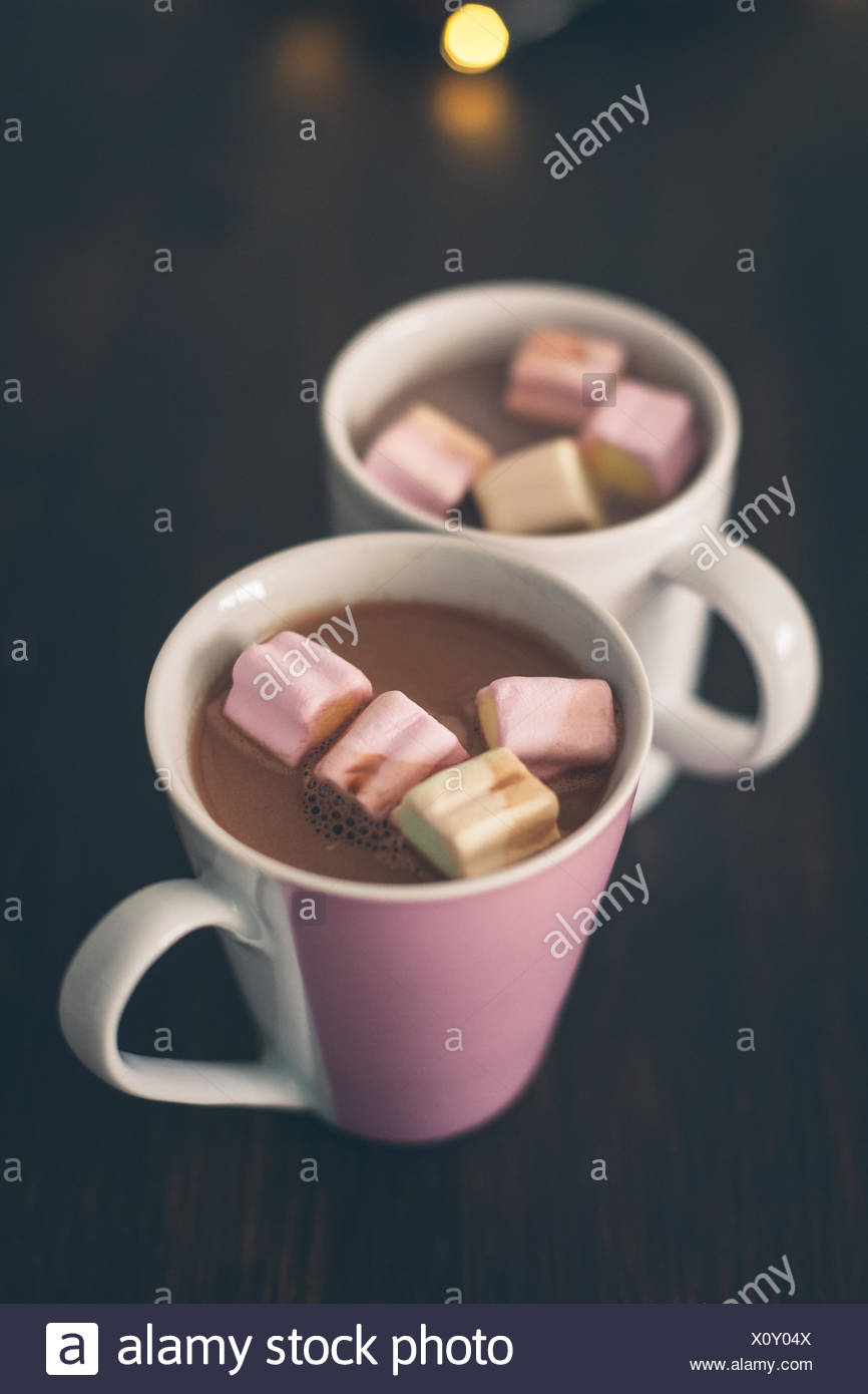Close-Up Of Marshmallow In Hot Chocolate Mug Served In Table - Stock Image