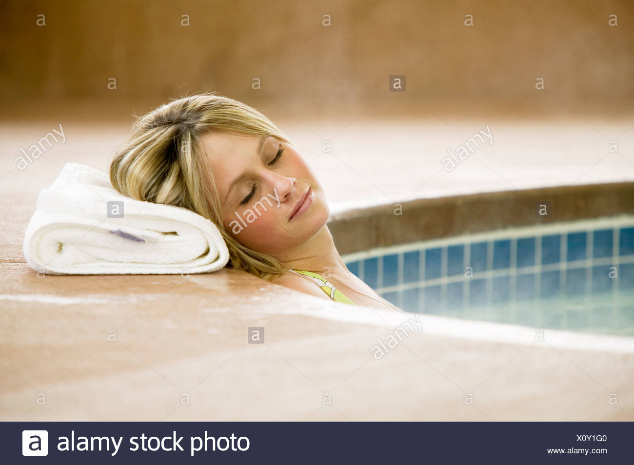 Woman relaxes in hot tub.  Port Alberni, Vancouver Island, British Columbia, Canada. - Stock Image