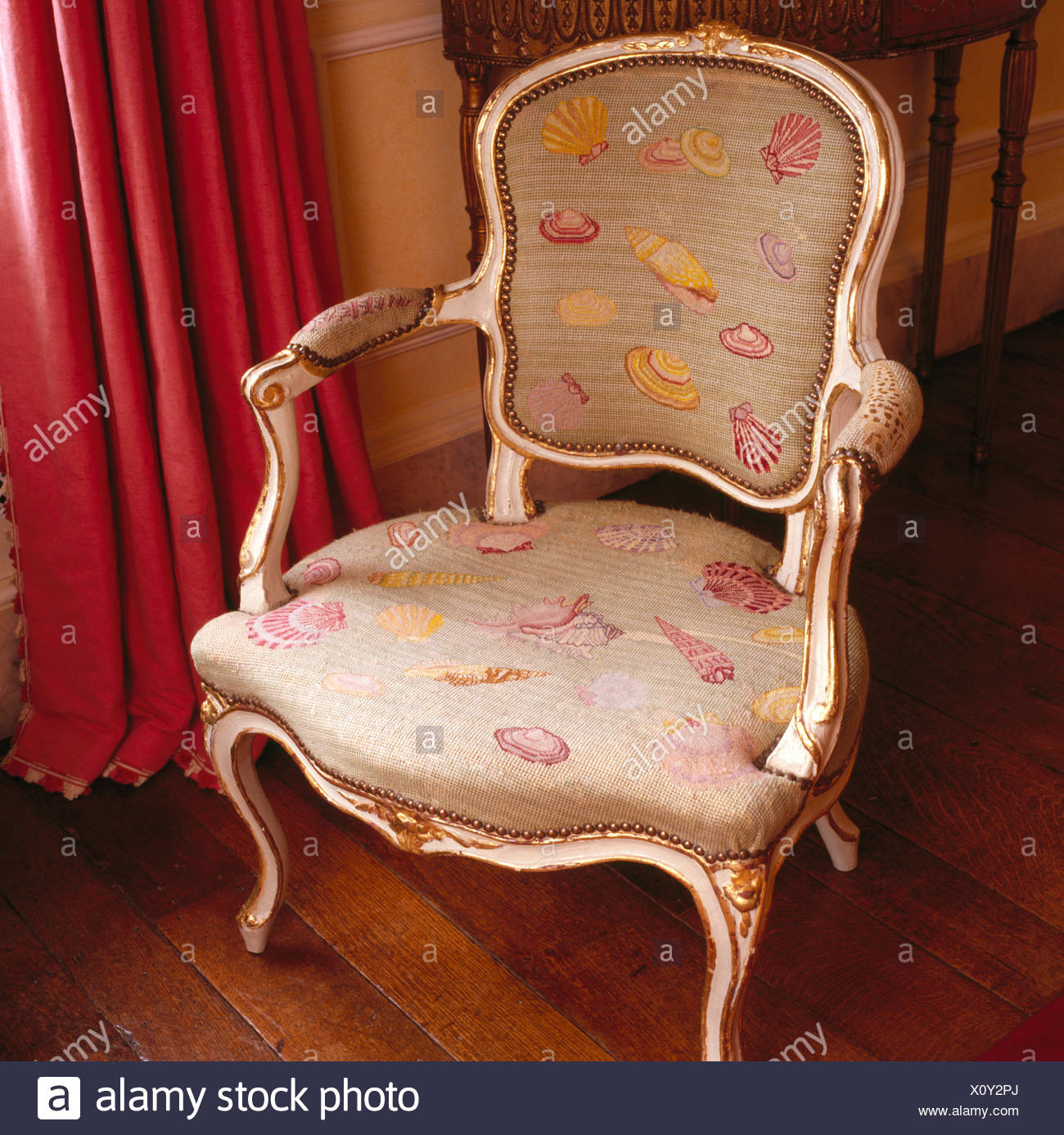 French style chair upholstered in seashell patterned fabric designed by Henrietta Spencer-Churchill - Stock Image