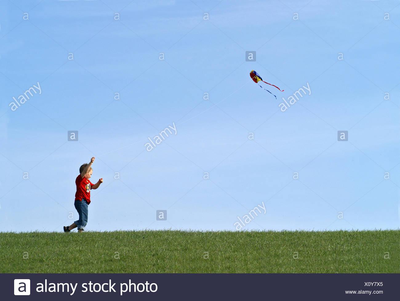 1 child,kite - Stock Image