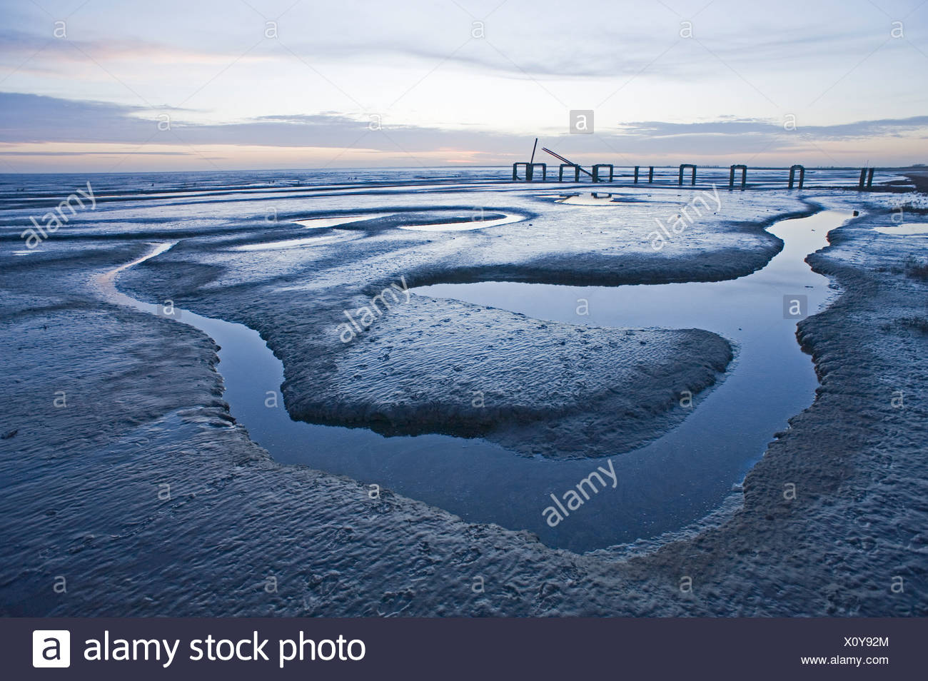 The Wash viewed from Snettisham RSPB Reserve Norfolk at dusk and at low tide in winter - Stock Image