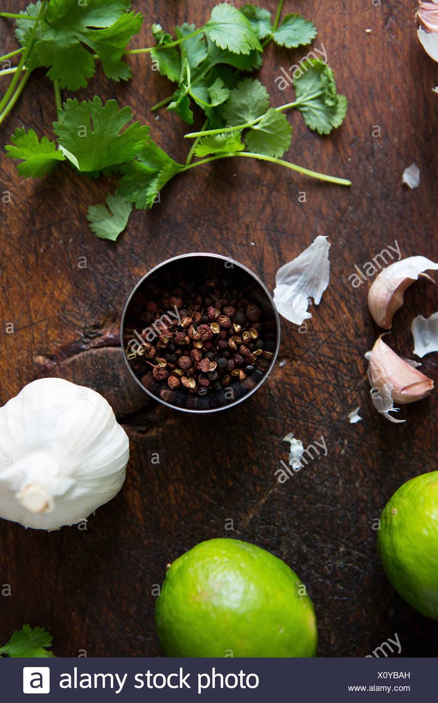 Ingredients. Coriander, lime, garlic, pepper - Stock Image
