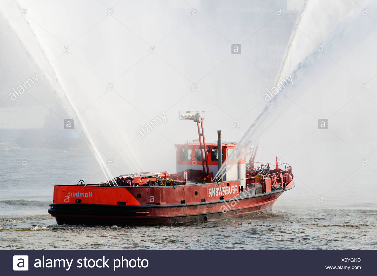Fire boat of the Hamburg Fire Department displaying water cannon during the harbour anniversary celebrations in 2011, Hamburg - Stock Image