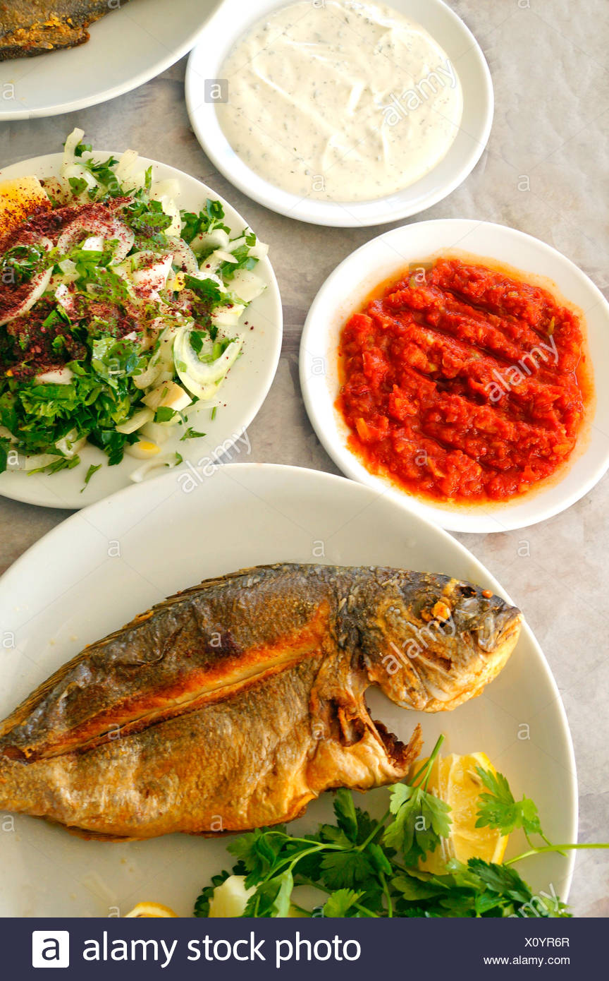 Fish from the Beysehir lake, with salads of hot tomatoes