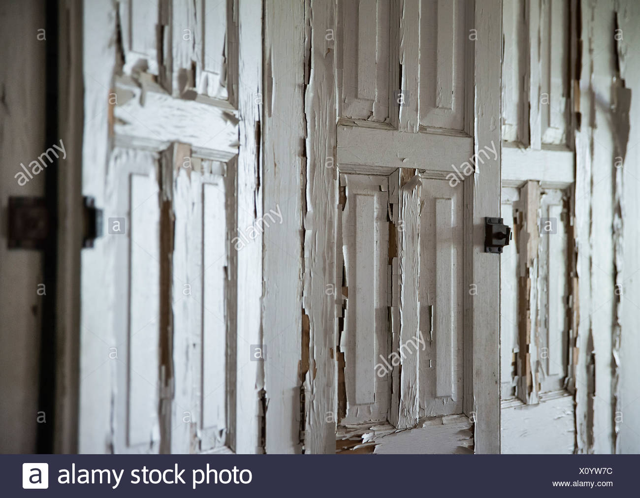 Neglected cabinets with peeling paint. - Stock Image