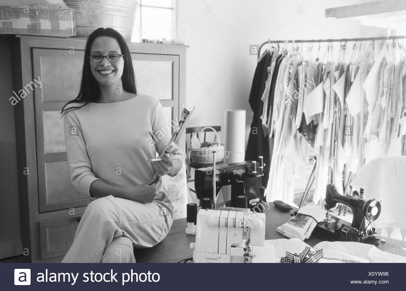 Young Hispanic Fashion Designer Starting Up Her Business In Her Home Garage Stock Photo Alamy
