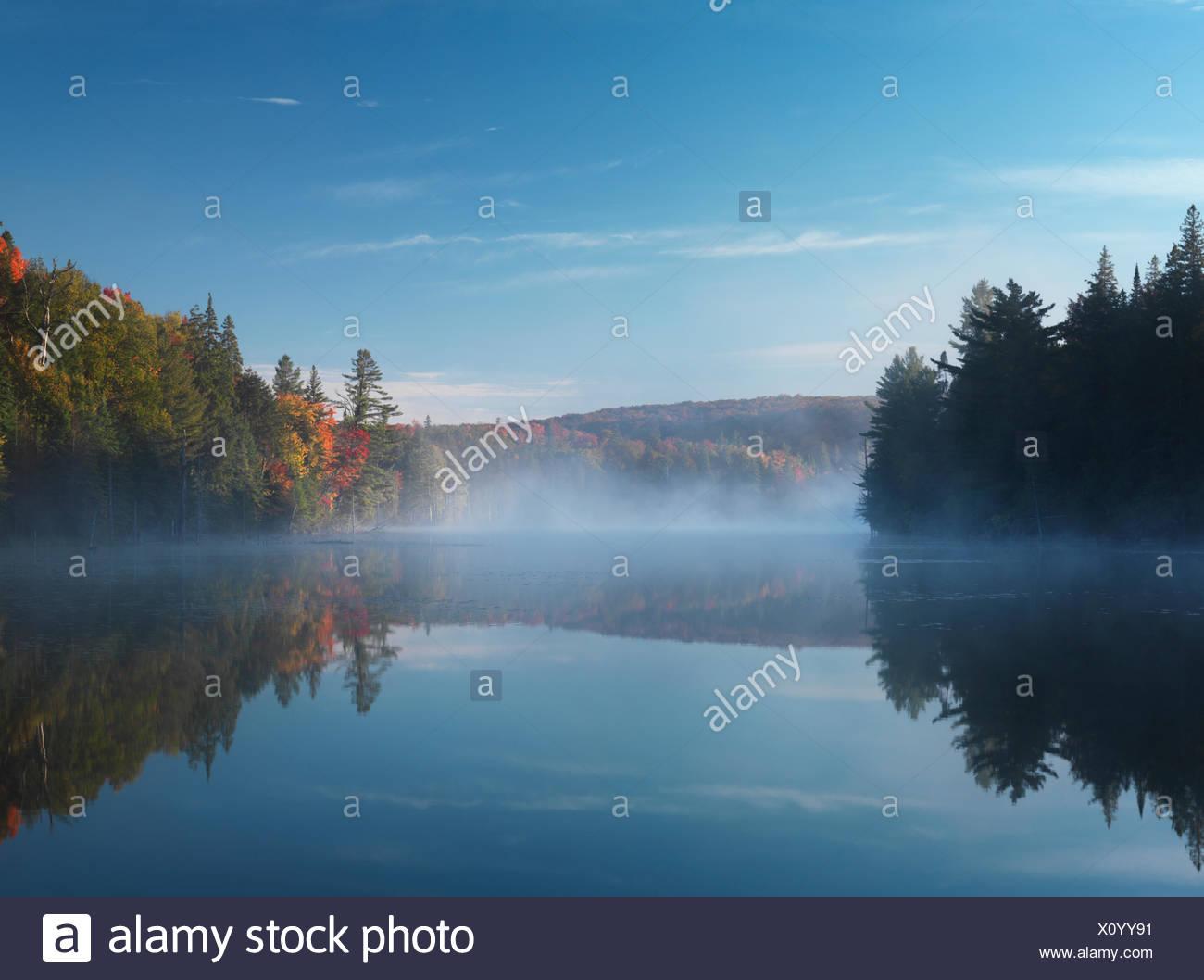 Mist over Smoke lake, Algonquin Provincial Park, Ontario, Canada - Stock Image