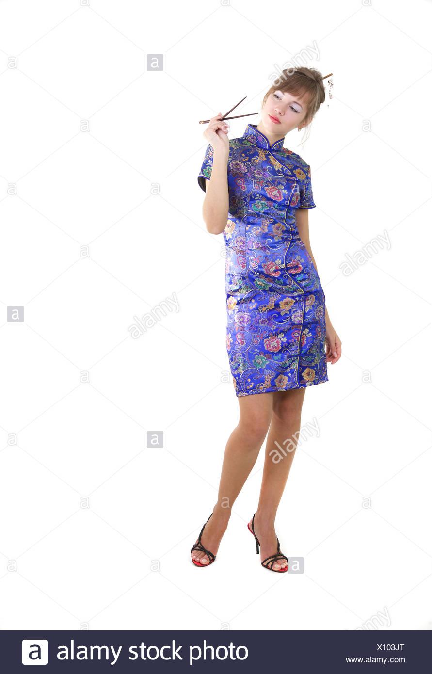 Woman with chopsticks Stock Photo