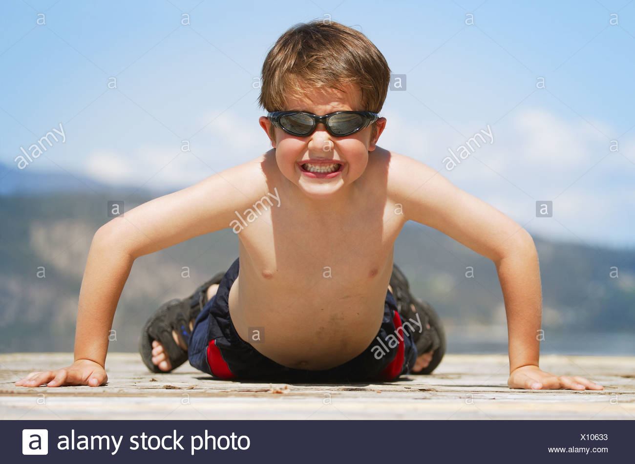 Child does a pushup - Stock Image