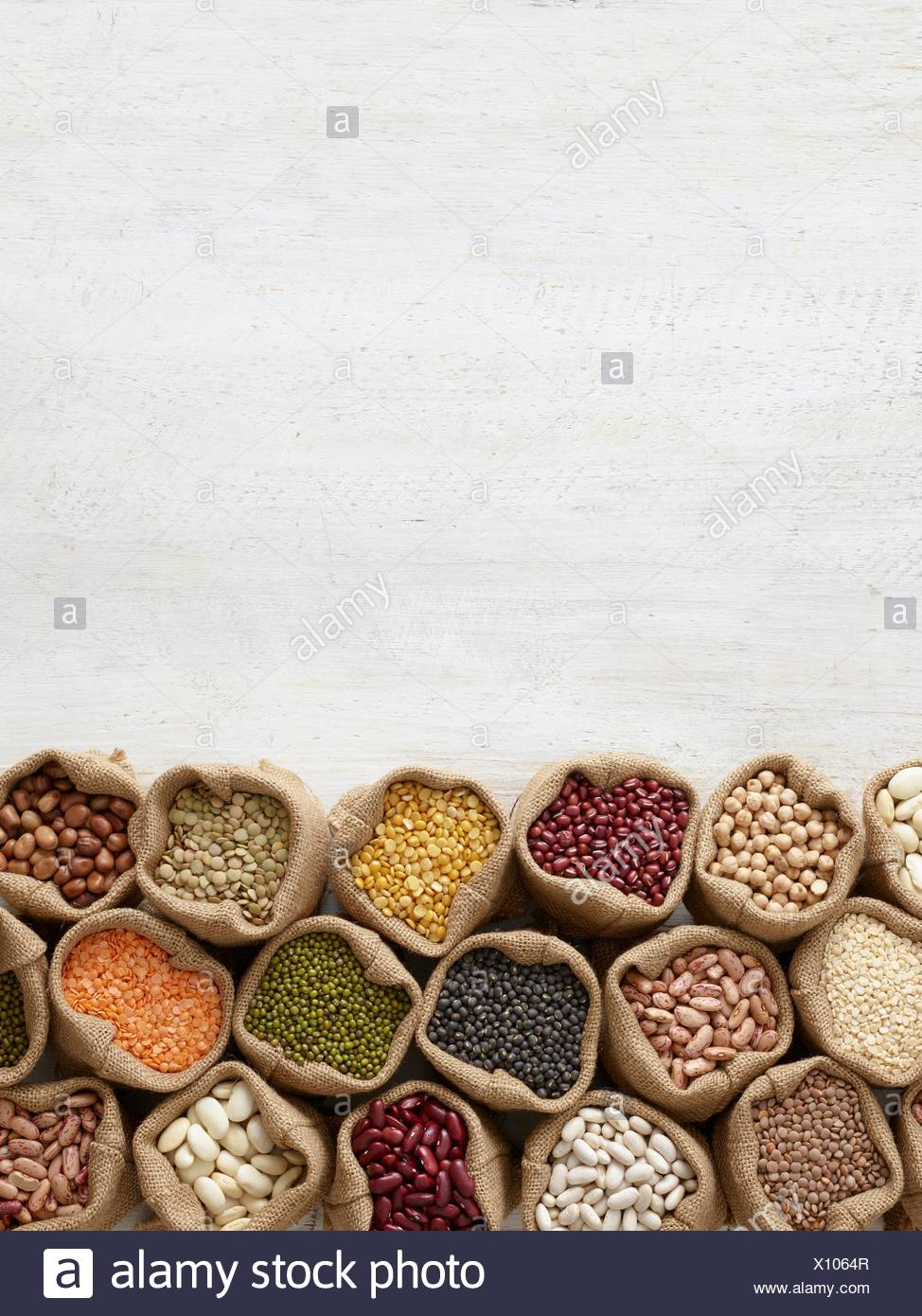 Pulses in hessian sacks, overhead view. - Stock Image