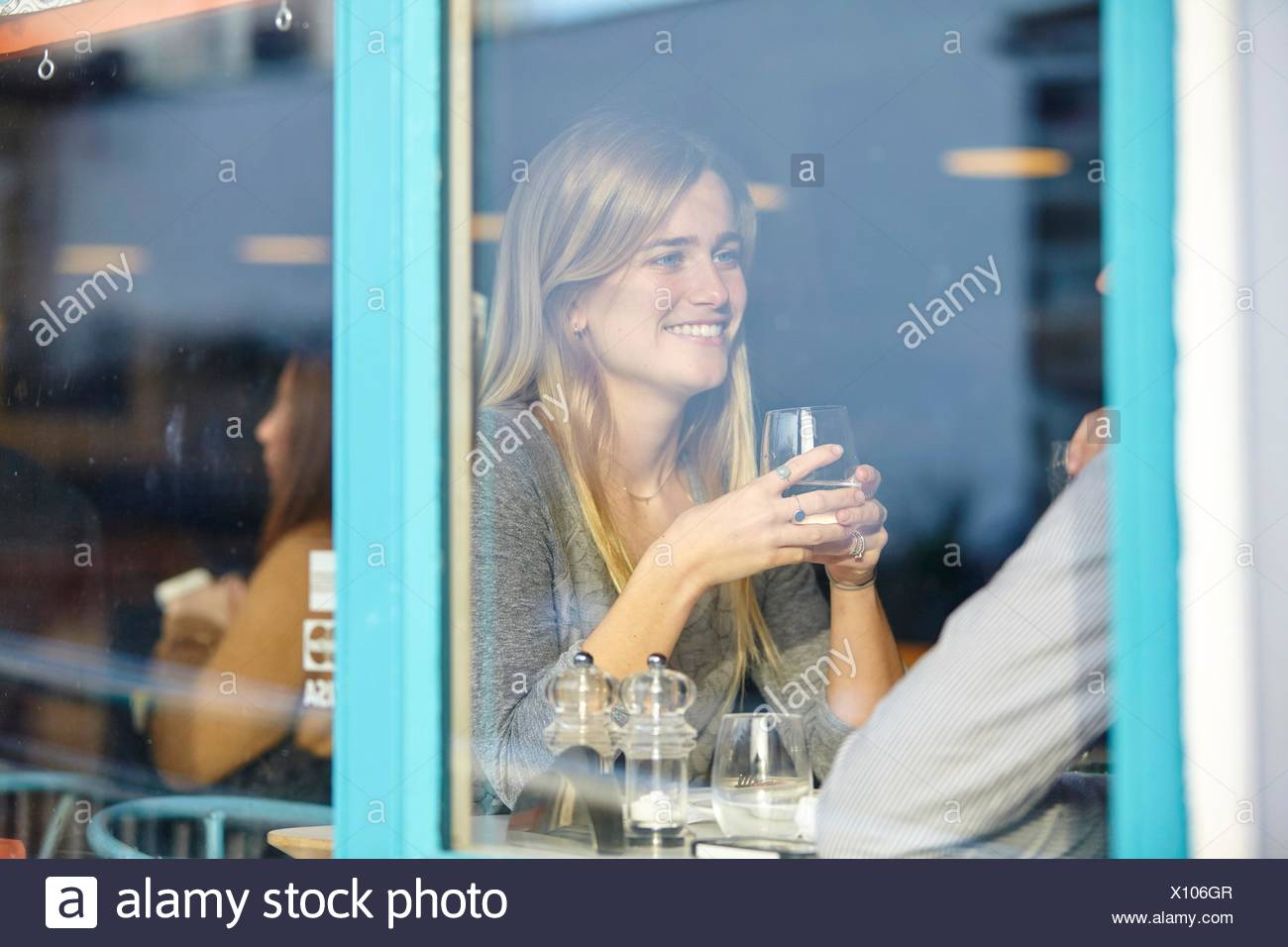 Romantic young couple at cafe having lunch date - Stock Image