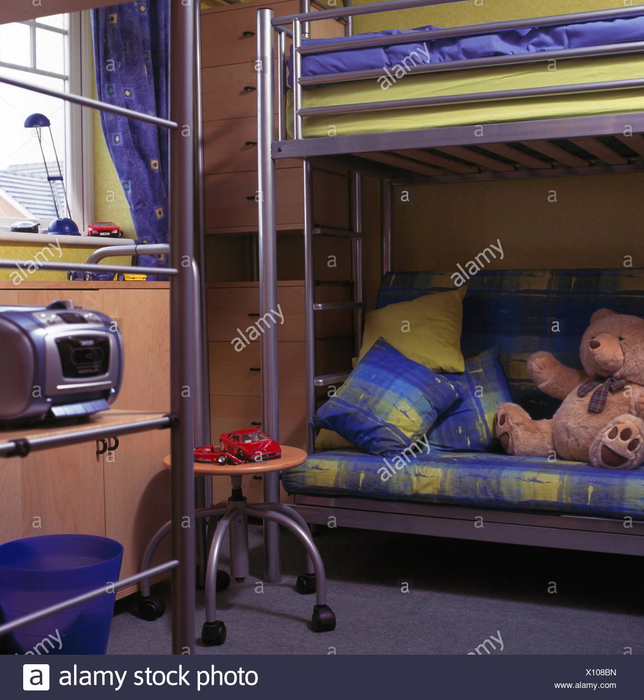 Picture of: Blue Green Cushions And Linen On Stainless Steel Bunk Beds In Children S Nineties Bedroom With Retro Radio Stock Photo Alamy