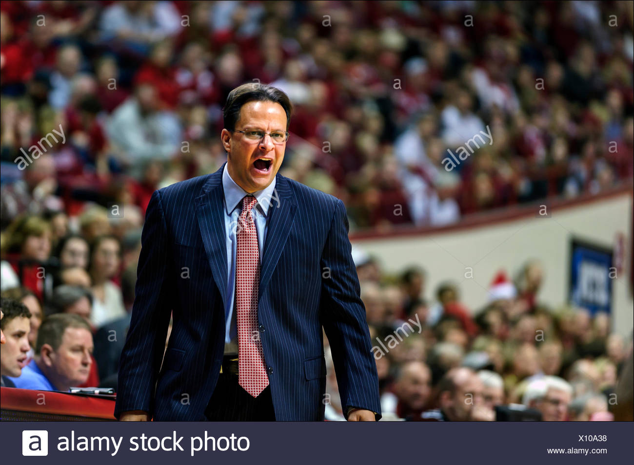 Indiana University head basketball coach Tom Crean shouts encouragement to players from the sidelines in Assembly Hall in Bloomington, Indiana. - Stock Image