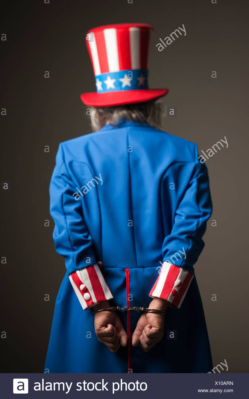 uncle sam in handcuffs - Stock Image