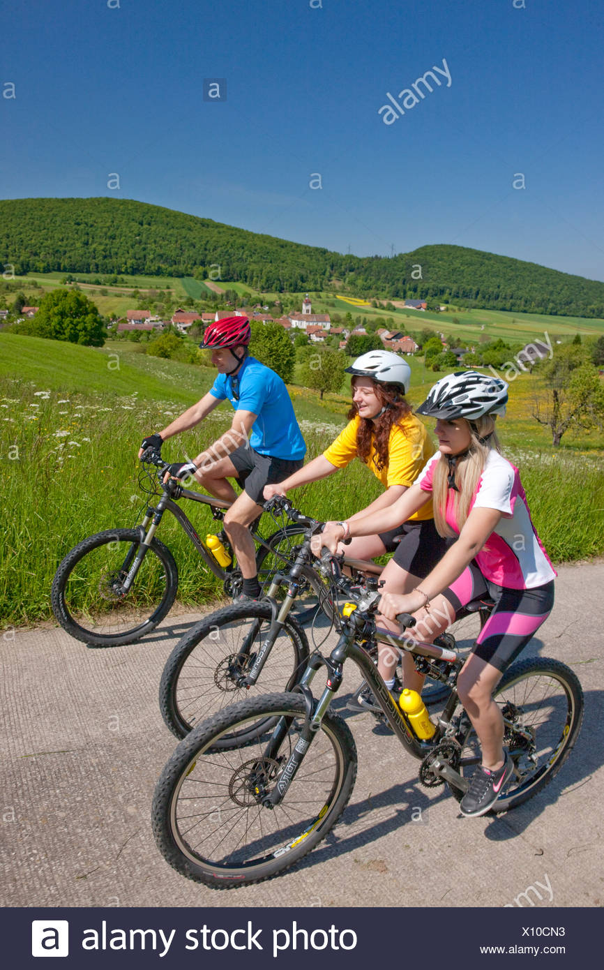 Switzerland Europe canton JU Jura Chamoille three group Lucelle mountain bike bike wheel bicycle bicycle bicycles riding a - Stock Image