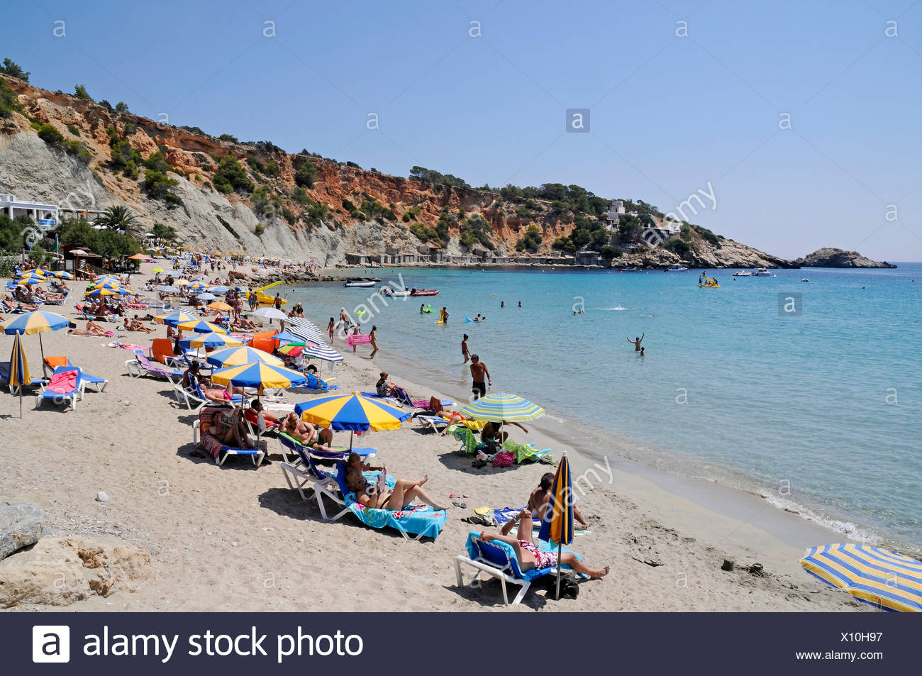 Holidaymakers on Cala d'Hort beach, Ibiza, Pityuses, Balearic Islands, Spain, Europe - Stock Image