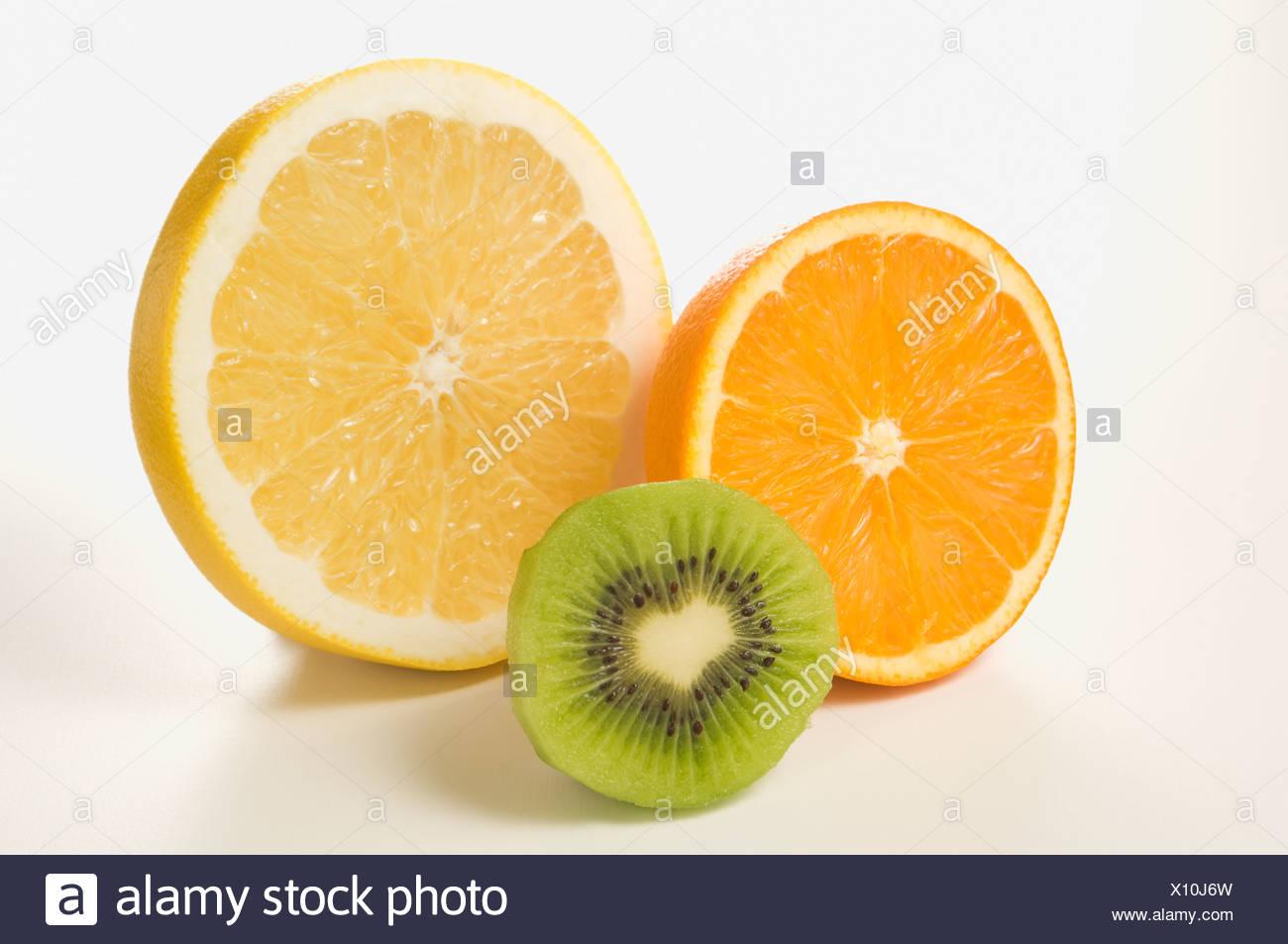 Half Cut of Grapefruit, Orange and Kiwi fruit - Stock Image