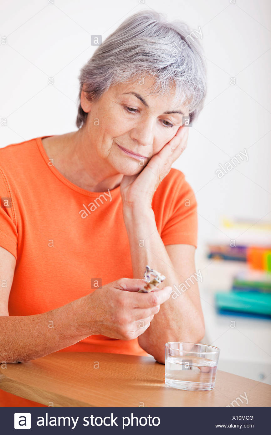 TIRED ELDERLY PERSON - Stock Image
