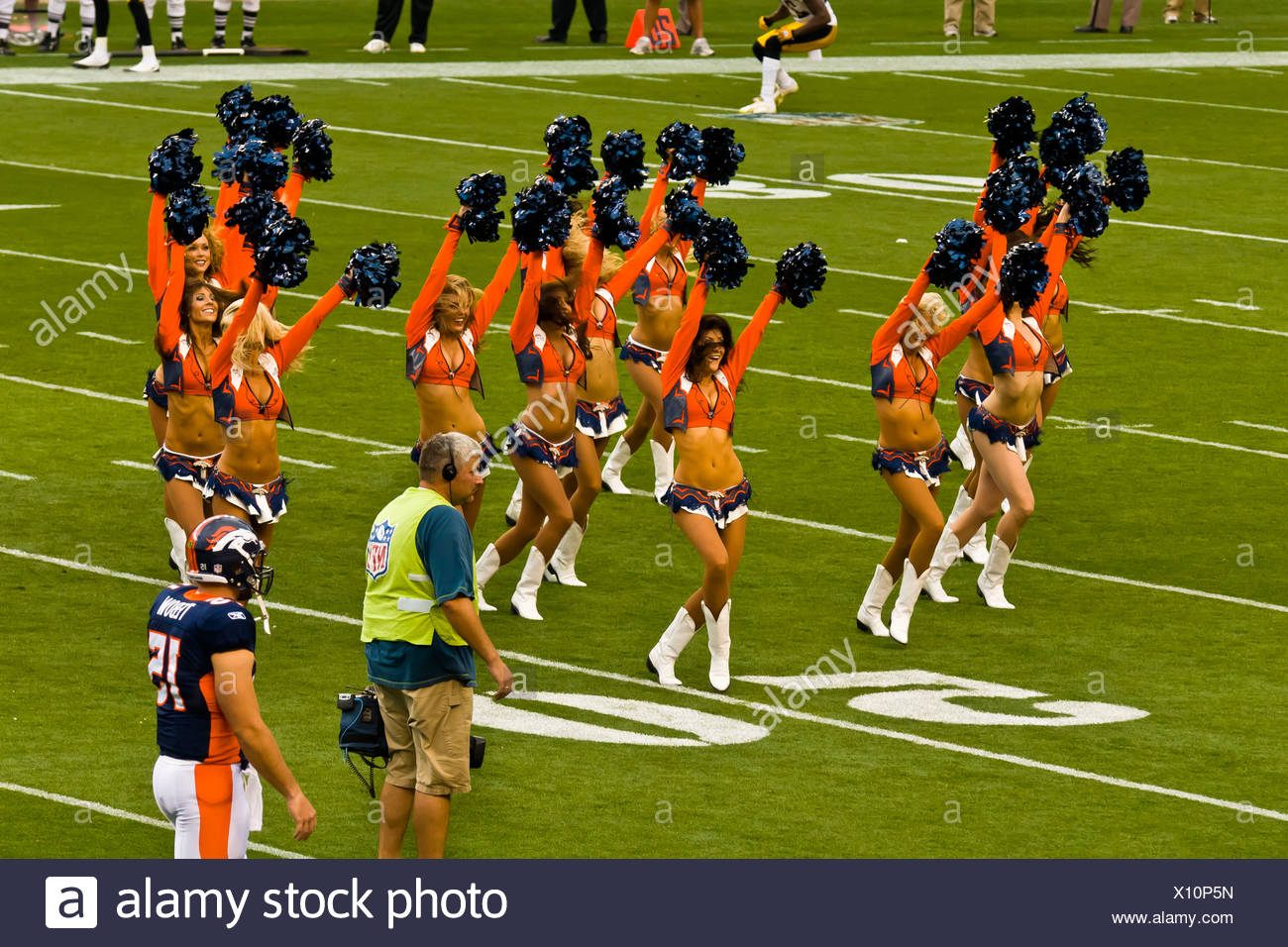 Denver Broncos Cheerleaders, Denver Broncos vs. Pittsburgh Steelers NFL football game, Invesco Field at Mile High (stadium), - Stock Image