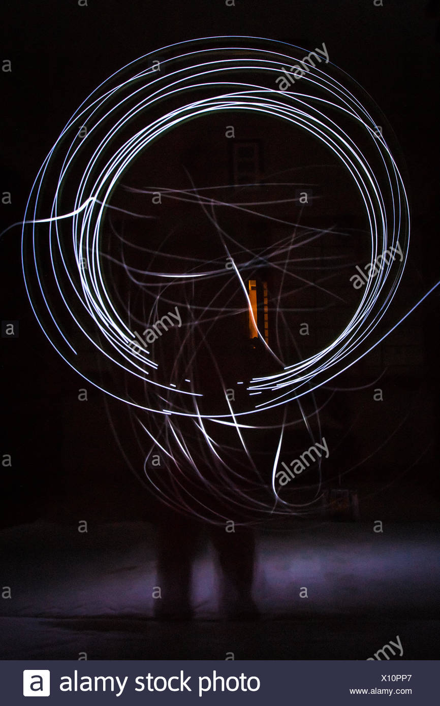 Illuminated Spiral Light Trails - Stock Image