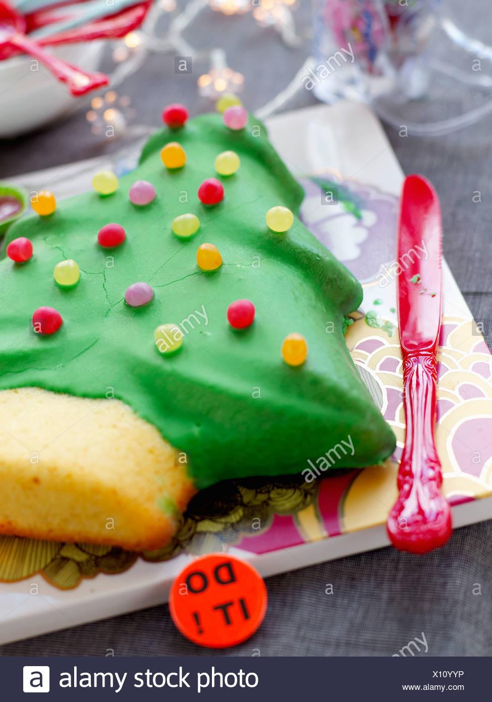 Christmas tree-shaped cake decorated with Dragibus Stock Photo ...