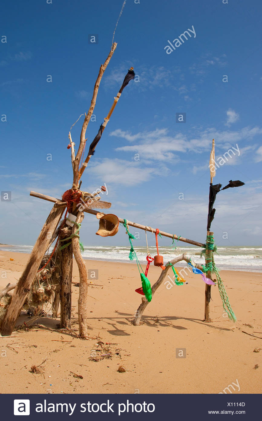 mobile at the sand beach made of flotsam and left toys and litter, Italy, Sicilia - Stock Image