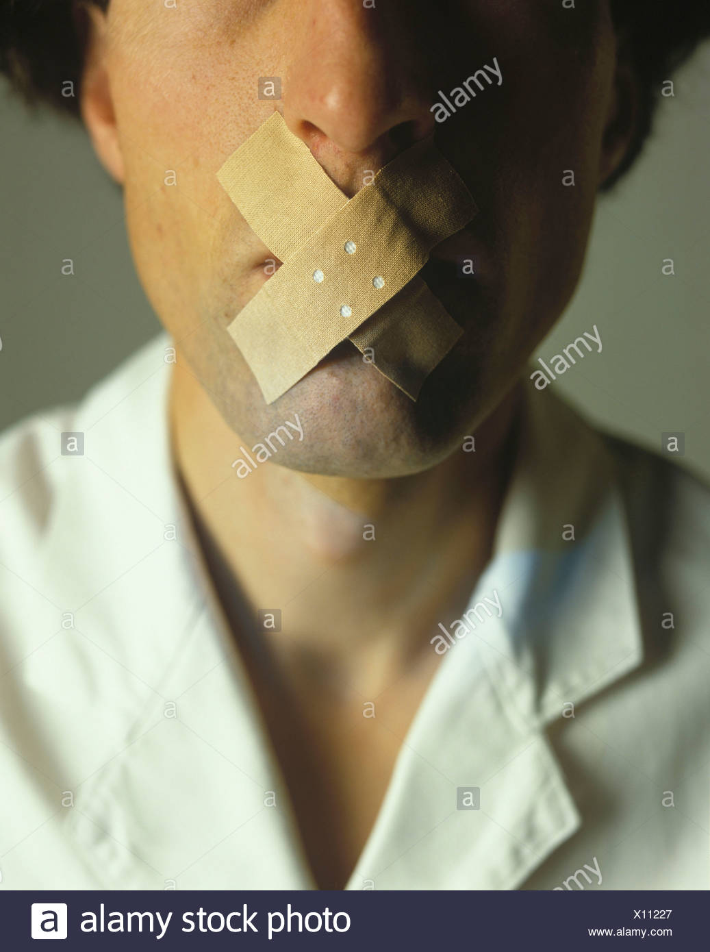 doctor toggle plaster talk rest silence oath of secrecy silence calmness ban forbidden - Stock Image