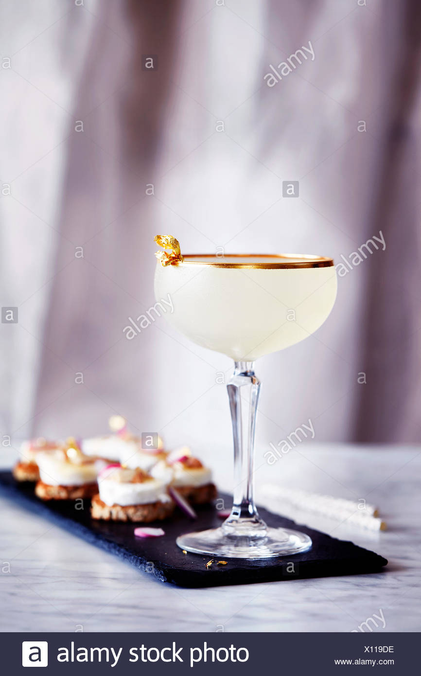 Toffee rum punch, with canapés - Stock Image