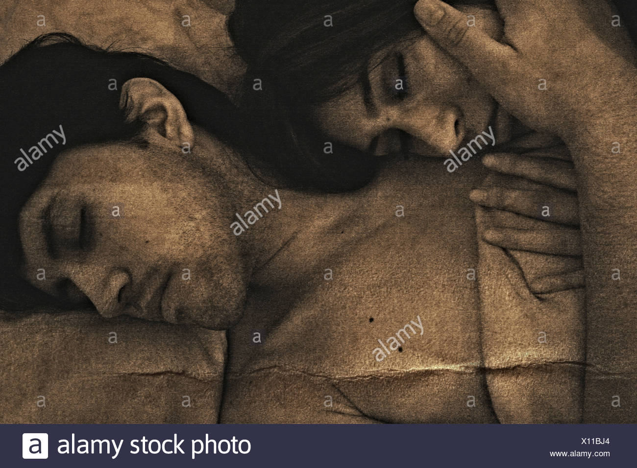 A young man and a woman lying together - Stock Image