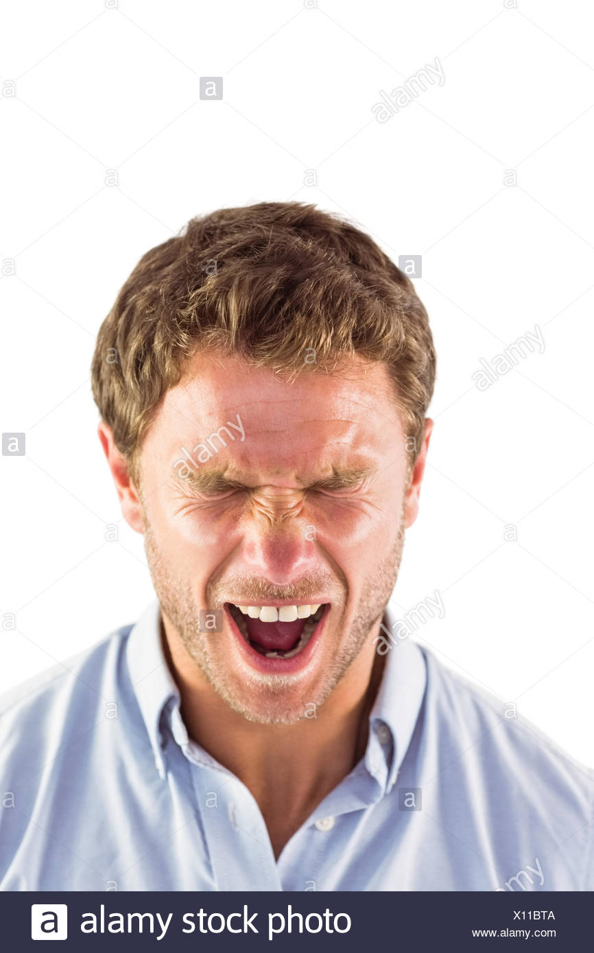 Angry man shouting towards camera - Stock Image