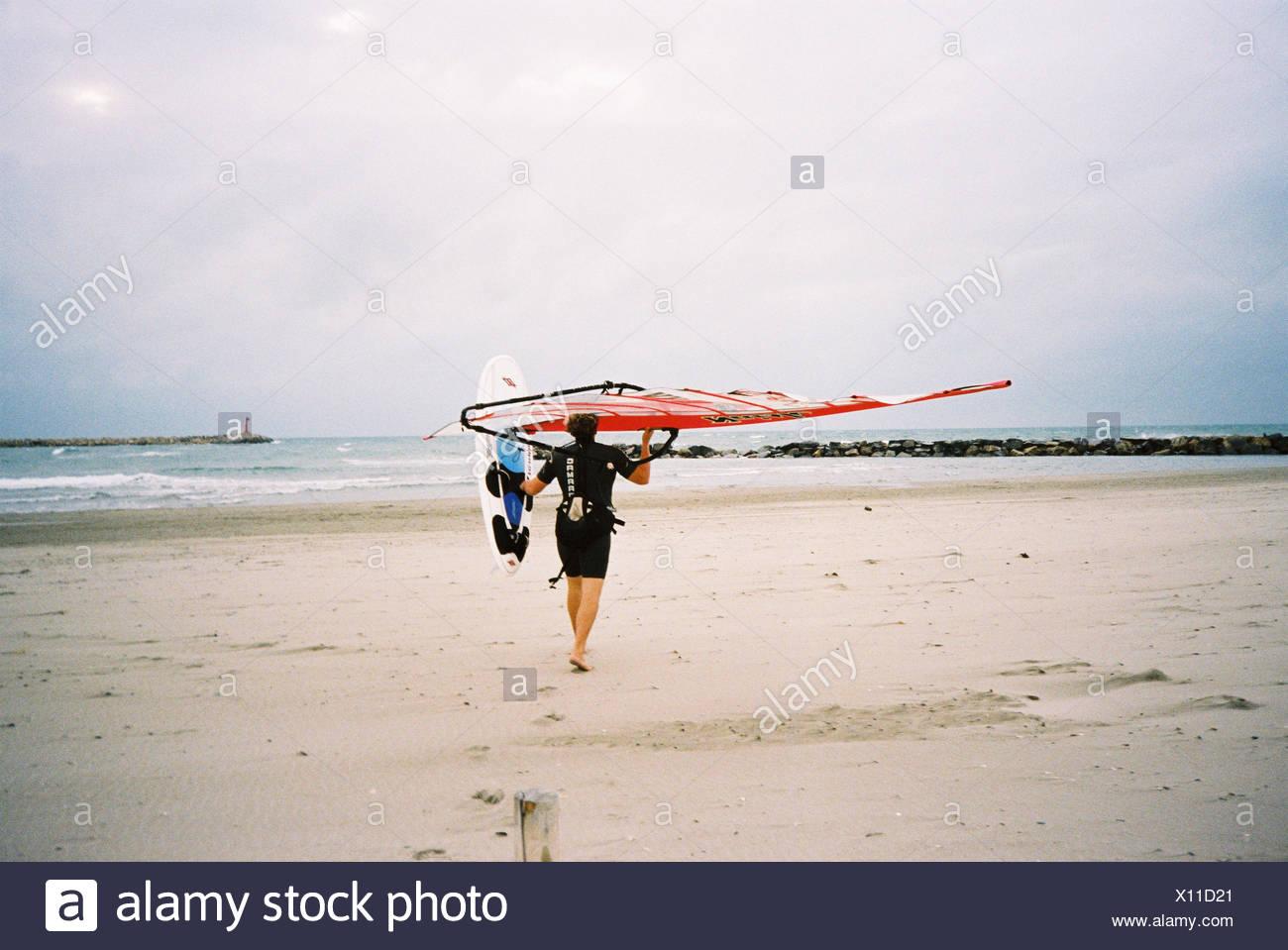 Man, surfboard, beach, carries,  Move opinion,   France, St. Marie of de la Mer, sea, windsurfers, Speedsurfer, Finian Maynard, athletes, sport, surfing, windsurfing, windsurfing, surfboard, board, sails, training, - Stock Image