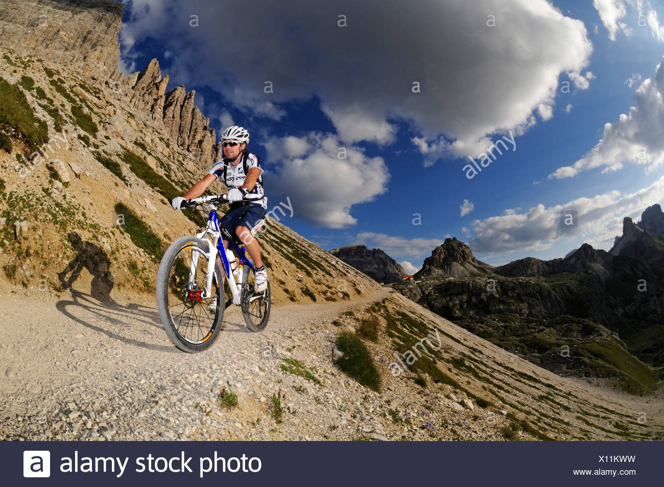 Mountain bike pro Roland Stauder in front of Patern Pass, Alta Pusteria, Dolomites, South Tyrol, Italy, Europe - Stock Image