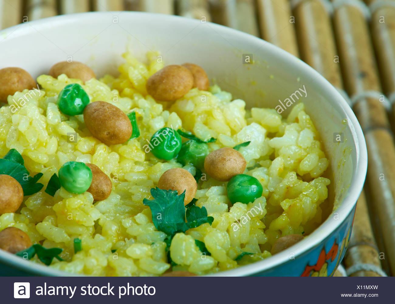 Flattened rice  Kande Pohe - Stock Image