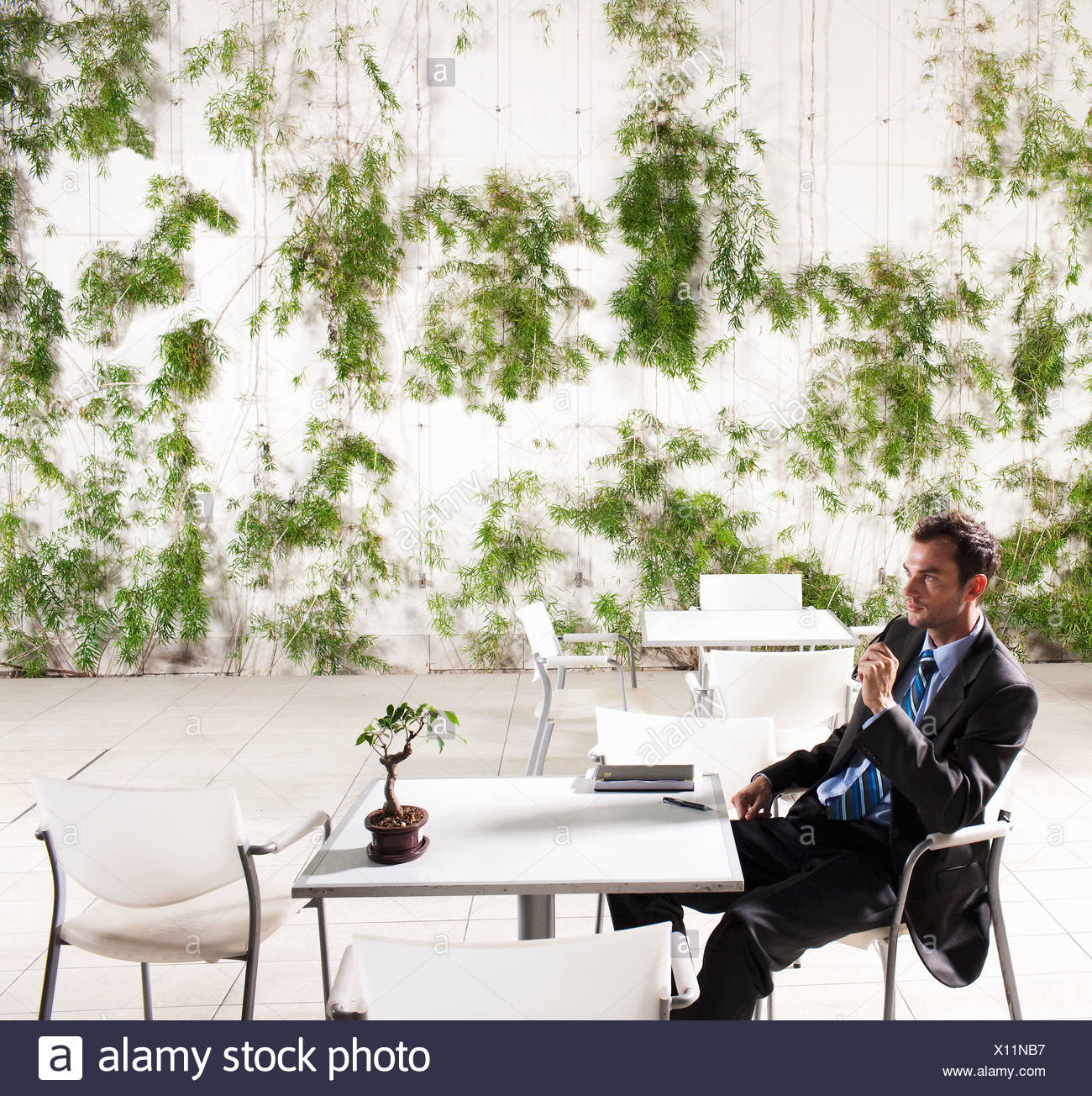 Business man at table - Stock Image