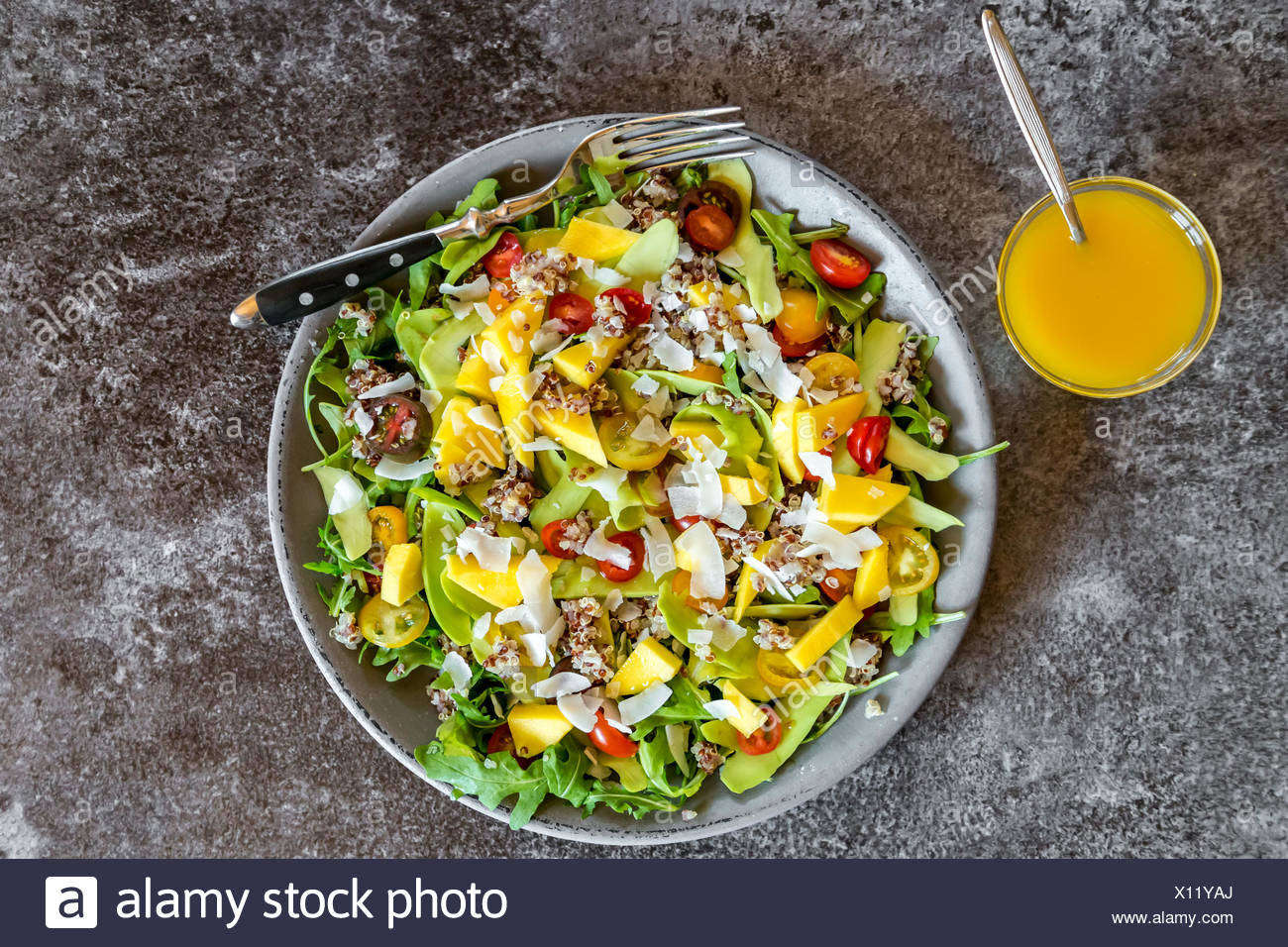 Fresh Salad With Rocket Quinoa Avocado Mango Tomato And Cocos