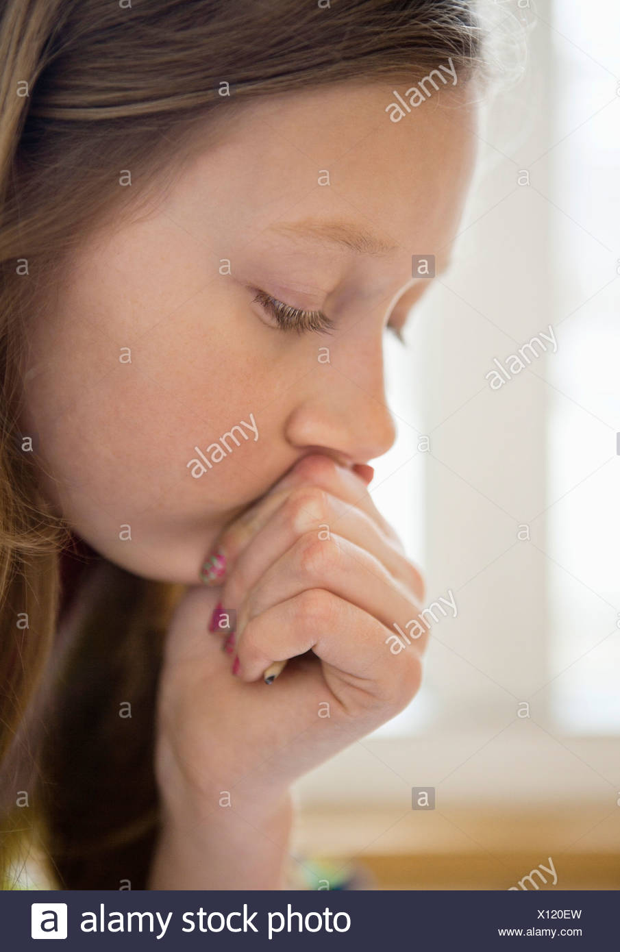 Close-up of girl concentrating on something - Stock Image