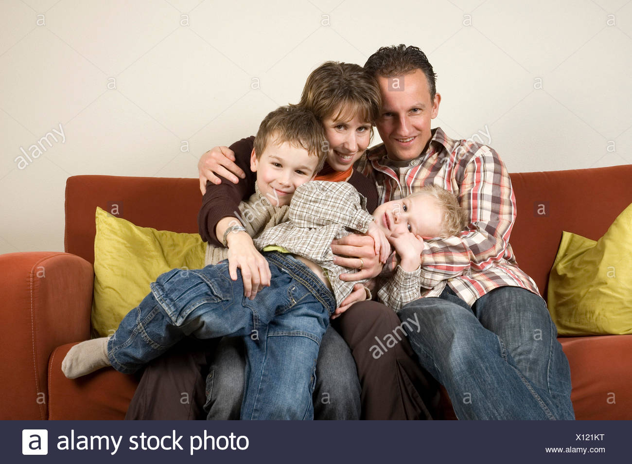 Family On A Couch 3 - Stock Image