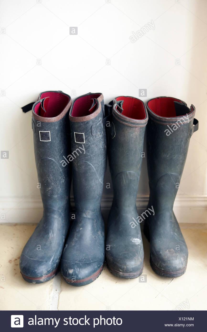 UK, England, Glastonbury, Two pairs of Wellington Boots - Stock Image