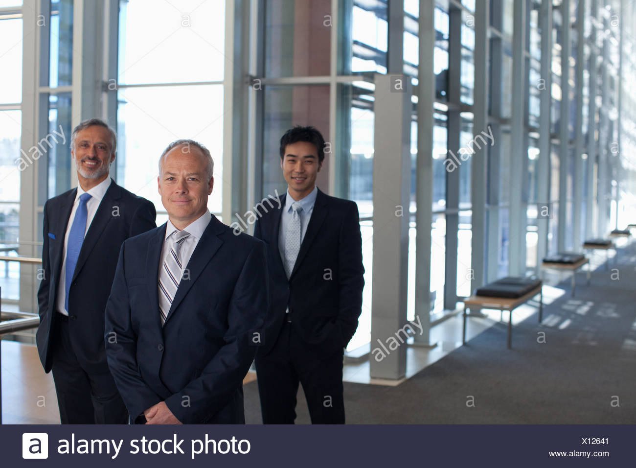 Business people in office lobby - Stock Image