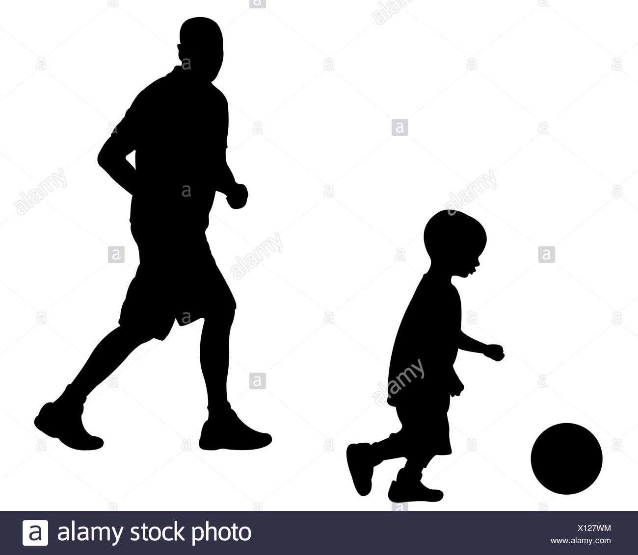 dad and son playing football - Stock Image